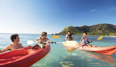 family kayaking in fiji